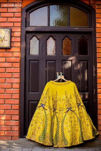 Photo of Hanging lehenga shot in yellow