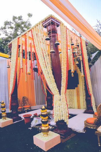 All floral South Indian mandap decor with temple bells