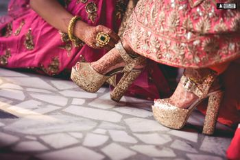 Photo of Gold glittery bridal heels with block heels