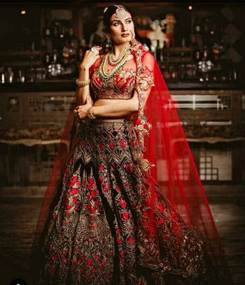 Winter wedding threadwork lehenga in black and red