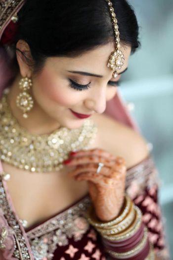 Pretty bridal portrait with sky pose