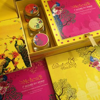Photo of Yellow and pink wedding invitation box and cards