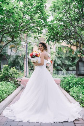 Flared white christian strapless wedding gown