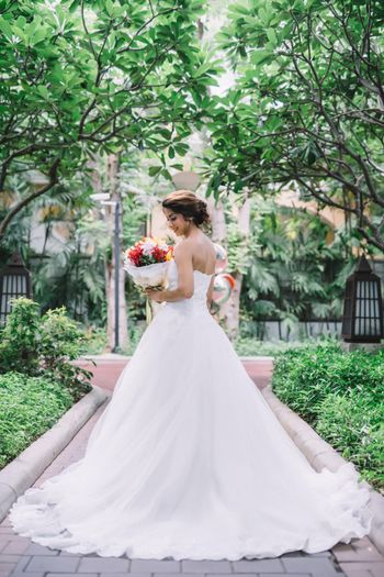 Flared white strapless christian wedding gown