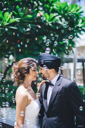 Pre wedding shoot with bubbles wearing christian wedding wear