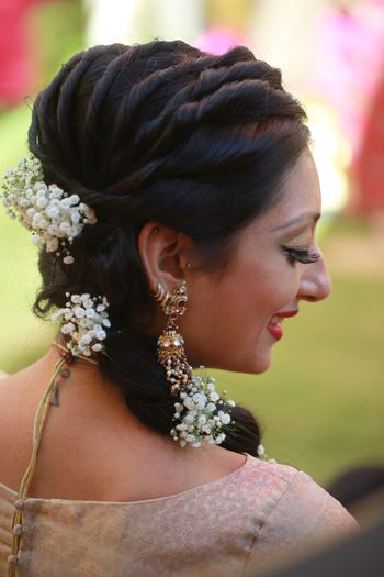 Twisted hairstyle for mehendi with babys breath