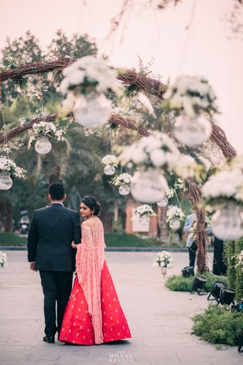Light pink and red lehenga with cape