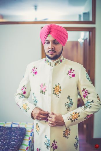 Groom in off white floral sherwani