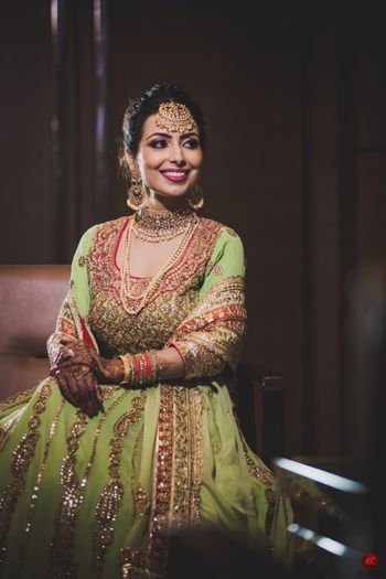 Gold engagement jewellery with layered necklaces and maangtikka