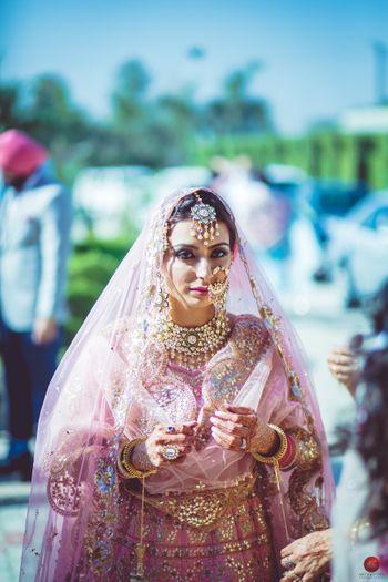 Sikh bridal portrait in light pink lehenga