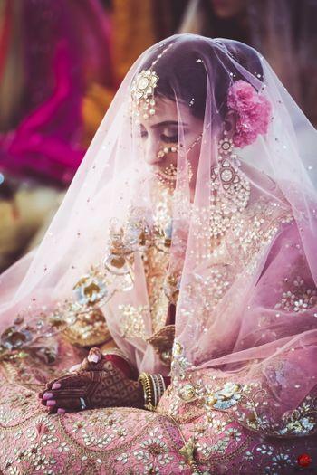 Bridal portrait with veil as dupatta on face