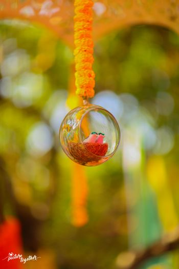 Hanging glass ball with nest and birds