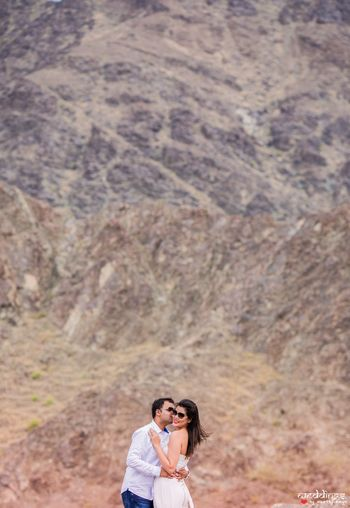 Couple kissing pre wedding shot in the hills