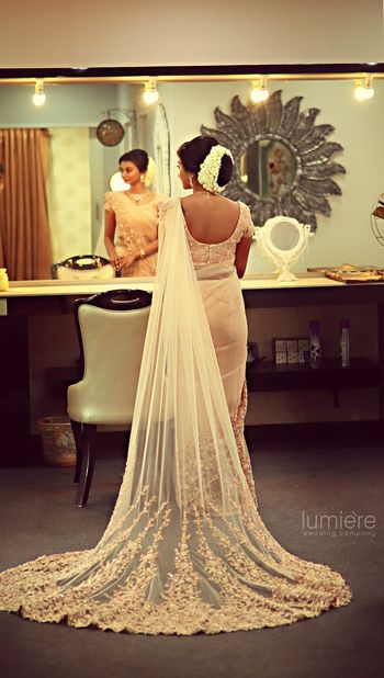 Photo of White lace saree with train for South Indian bride