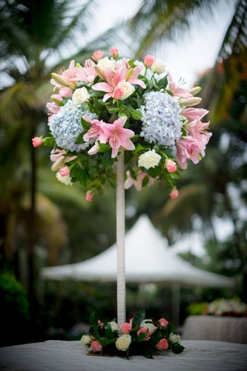 Photo of Unique table floral centrepiece on a stick