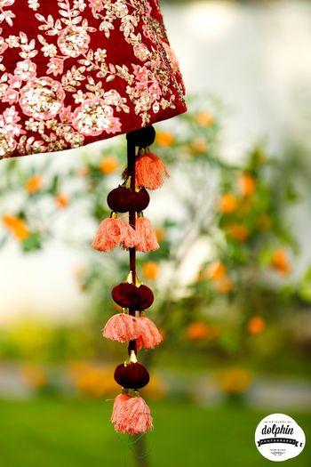 Unique lehenga latkans in maroon and peach