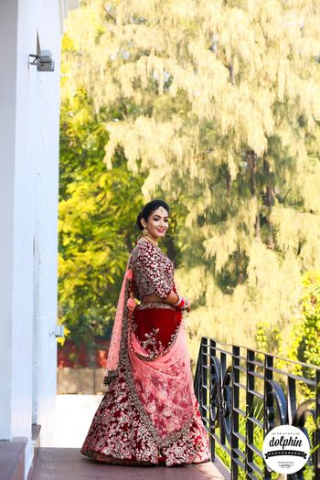 Maroon bridal lehenga in velvet with pink dupatta