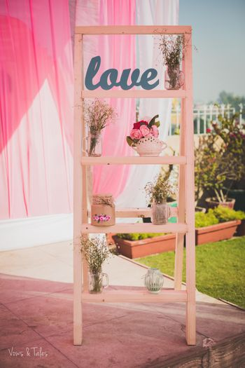 Photo of Wooden ladder decor with floral arrangement