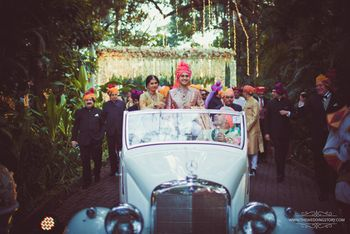 Groom entering in a white vintage car