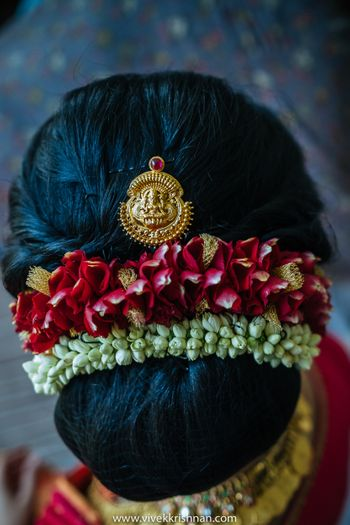 South Indian bridal hairstyle with flowers and jewellery