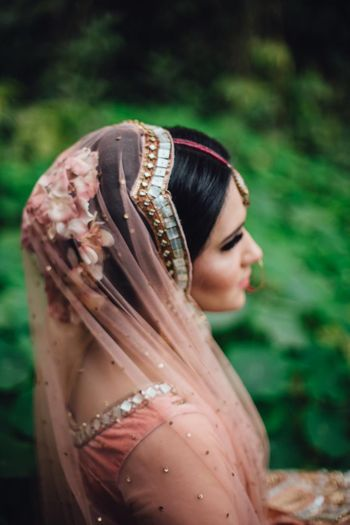 Light pink bridal bun and lehenga