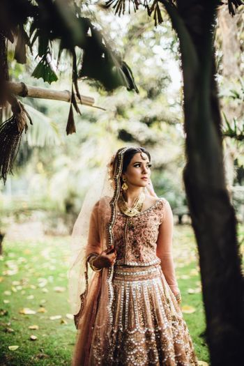Photo of Millenial pink mirror work bridal lehenga