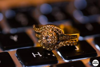 Engagement ring photography idea on a keyboard