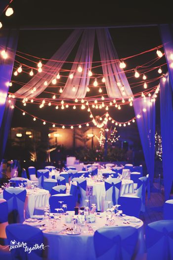 Intimate dinner setting with hanging bulbs