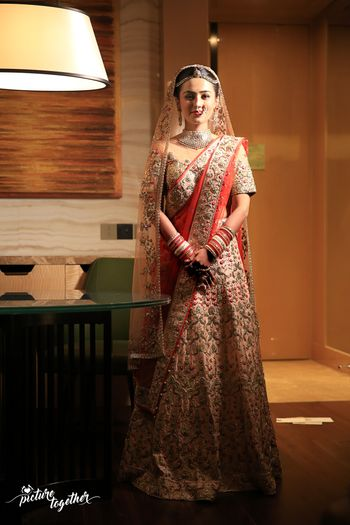 Light pink bridal lehenga with contrasting red double dupatta