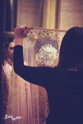 Bridal dupatta placing on head shot