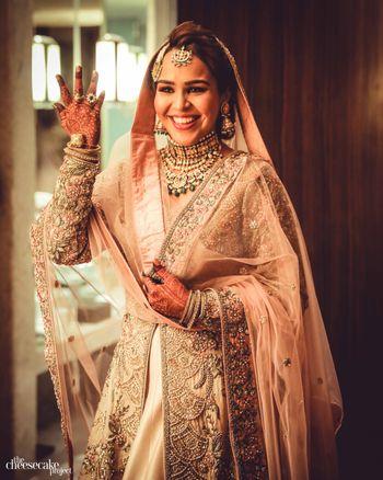 Muslim bridal look in peach Anarkali