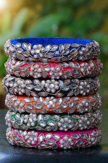 Photo of Fabric bangles with zardozdi and pearl work as mehendi favours