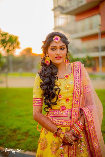 Yellow and pink gota jewellery for bride
