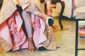 Photo of Lehenga with can can and bride wearing shoes