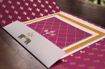 Photo of purple wedding cards