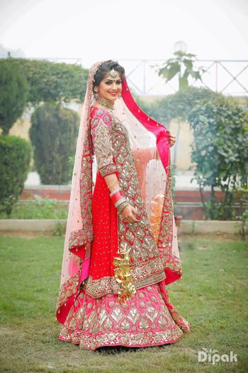 Sikh bride wearing red and pink lehenga with kurta