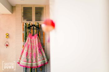 Photo of Pink lehenga on hanger shot