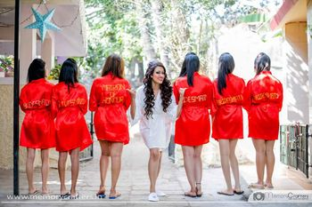 Bride with coordinated bridesmaids in robes
