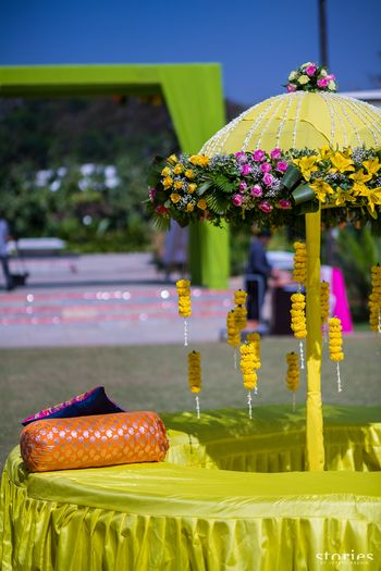 Mehendi floral decor in light green with garden umbrella