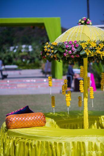 Photo of Mehendi floral decor in light green with garden umbrella