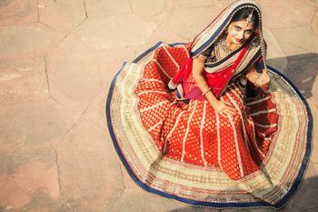 Photo of red banarsi lehenga with blue border