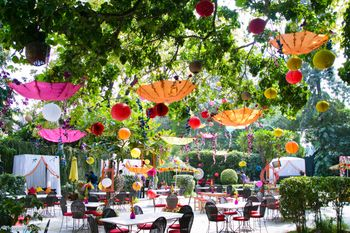 Hanging paper balls and umbrellas in decor