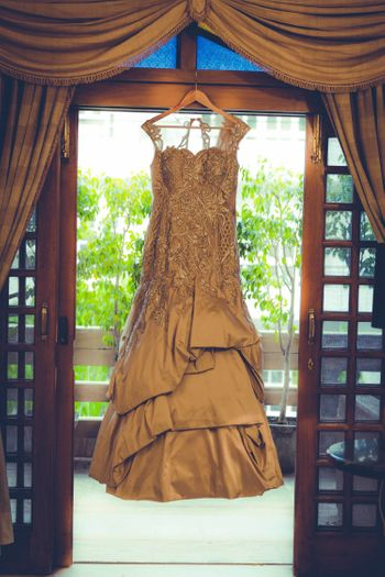 Layered dull gold cocktail gown