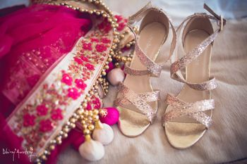 Photo of Dull gold strappy bridal heels