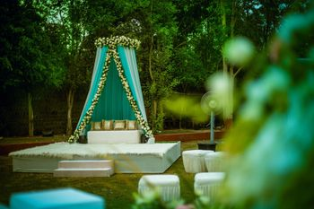 Mehendi seating with mint blue drapes and floral arrangements