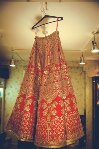 Red and gold hanging lehenga shot