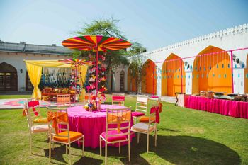 Photo of Bright and vibrant mehendi table decor