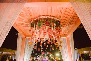 Photo of Peach wedding decor with hanging floral strings