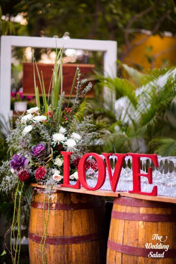 Photo of LOVE decor with floral arrangements