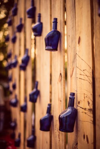Blue hanging bottles in decor
